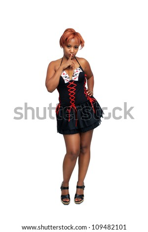 A full-length shot of a sexy young black woman with red hair.  Isolated on a white background with generous copyspace.