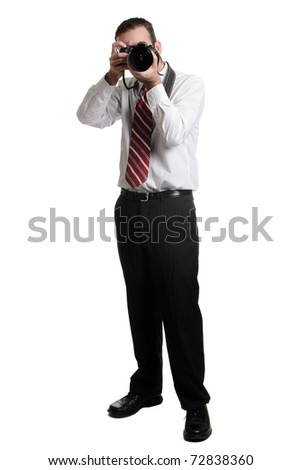 A full length view of a photographer using a DSLR, isolated against a white background. - stock photo