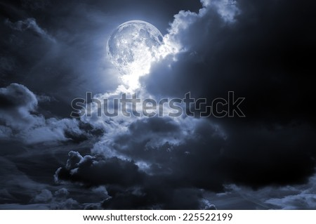 A full moon cloudy sky.