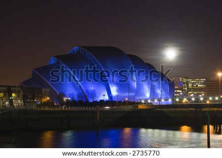 A full Moon rises over Glasgow's Armadillo building - stock photo