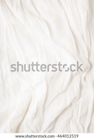 A full page close up of an off white crepe fabric texture