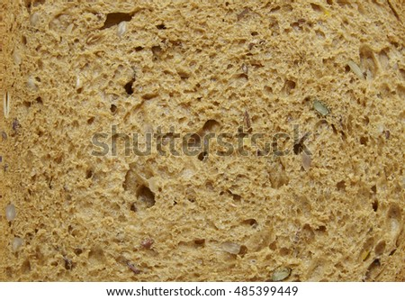 A full page crop of brown wholemeal bread background texture