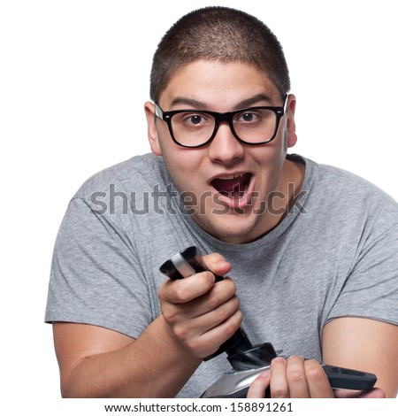A fun loving video gamer playing with a wireless joystick over a white background. - stock photo