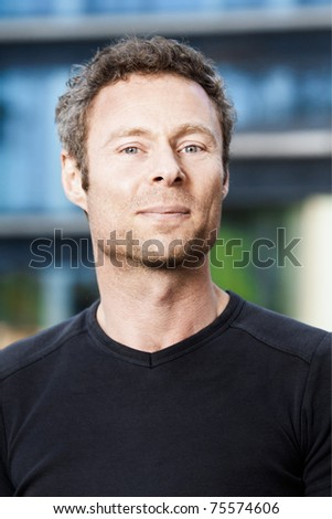 A fun portrait of a middle aged man outdoors - stock photo