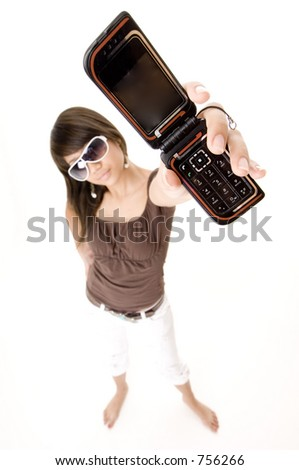 A funky girl holds up her phone - stock photo