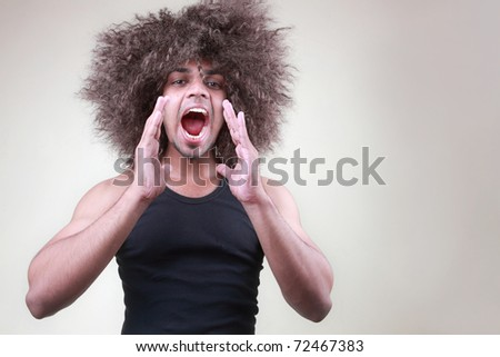 A funky man shouting loud - stock photo