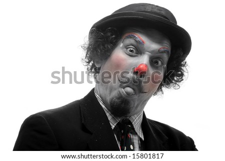 a funny clown is making silly faces - stock photo