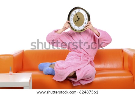 A funny girl in a pink gown with a watch in his hand - stock photo