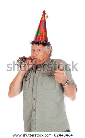 A funny image of an older gentlemen partying for his birthday.  He is giving a thumbs up.  Image is isolated on white. - stock photo