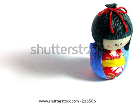a funny Japanese paper doll over white background with shadow - stock photo