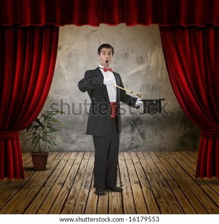 A funny magician on stage - stock photo