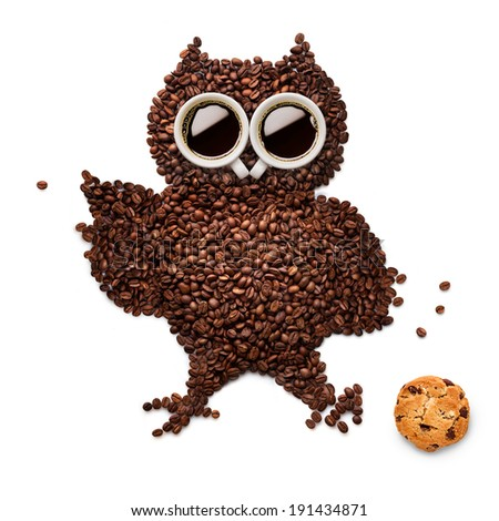 A funny owlet made of roasted coffee beans and two cups with an oatmeal cookie. - stock photo