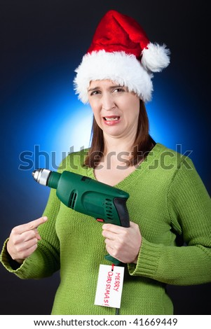 A funny scenario of a  woman upset with her Christmas gift. - stock photo