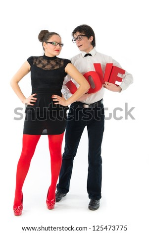 A funny young couple holding red letters love. - stock photo