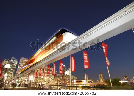 A futuristic shot of the Sydney Monorail shot at night in Darling Harbor - stock photo