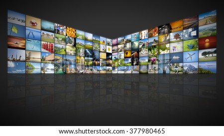 A futuristic video wall with 100 screens - stock photo