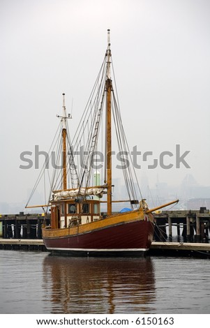 A gaff rigged ketch is tied to a dock, Baltimore, Maryland - stock photo