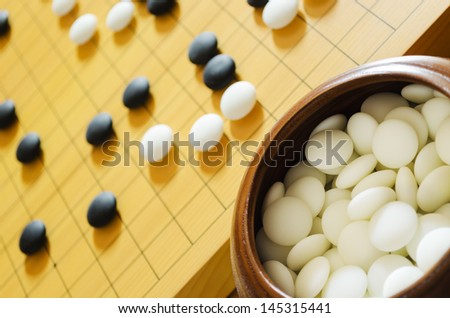 A game of go. Focus on foreground stones.