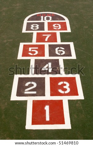 a game of hopscotch painted in a school yard - stock photo