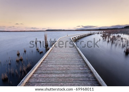 A gangway over a lake during the sunset. Lake of Pitillas, Navarra (Spain) - stock photo