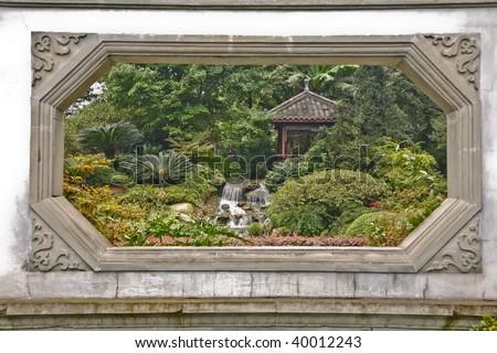 A garden view through a window - stock photo