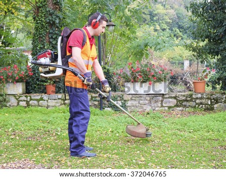 a gardener working in a park - stock photo