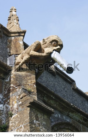A gargoyle on a church roof.