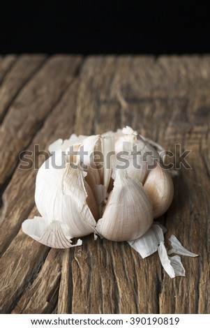 A garlic  bulb on a rustic wooden table.
