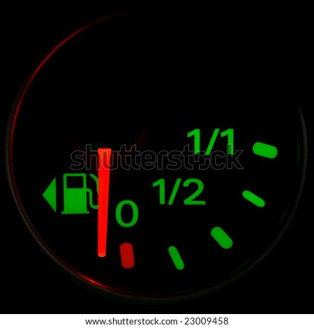 A gas gauge shows petrol level on a black background - stock photo