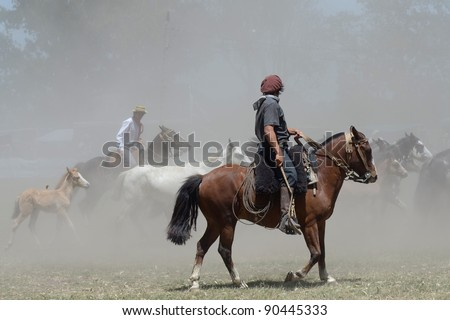 A Gaucho rides a horse in Buenos Aires, Argentina - stock photo