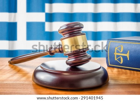 A gavel and a law book - Greece - stock photo