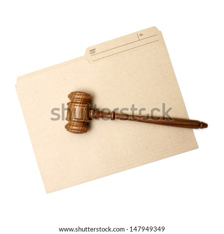 A gavel and folder represent legal documents. - stock photo