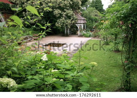 A gazebo in the garden with climbing roses. Palace Formal Garden, Czech Republic, Ratiborice, Grandmother�s Valley. - stock photo