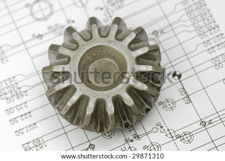 A gear with engineering drawing background