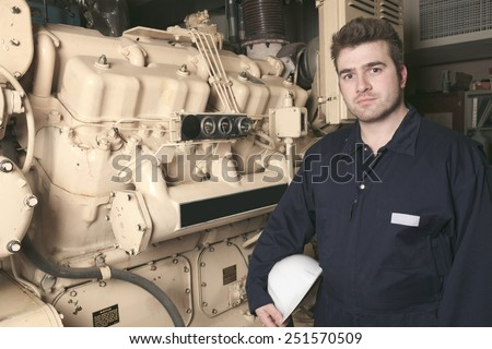 A generator  in a hospital with a repair men. - stock photo