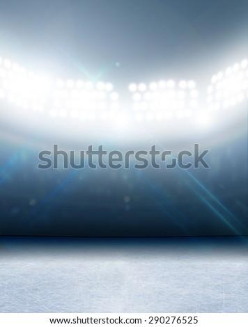 A generic ice rink stadium with a frozen surface under illuminated floodlights - stock photo