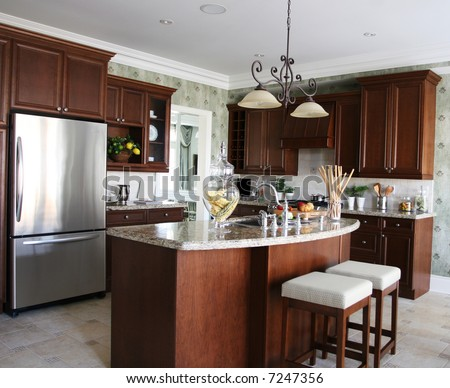 A generic kitchen with mahagony cupboards and stainless steel appliances.