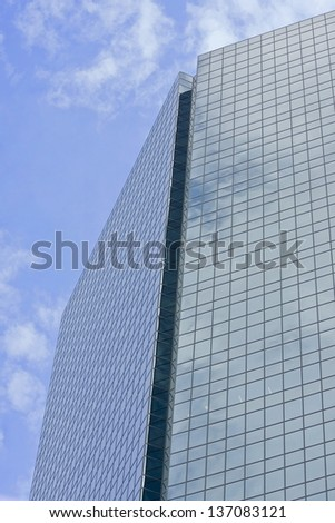 A generic tall modern glass-windowed building - stock photo