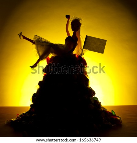A generic toy doll bride silhouette is seated on top of large pile of candy against a warm yellow background.