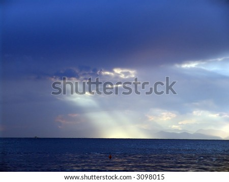 A generic view of a sea and a shore in the evening
