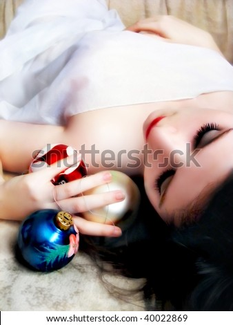 a gentle girl with christmas decoration - stock photo