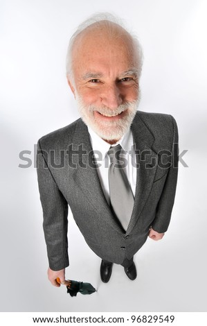 a gentleman holds an umbrella in wide angle - stock photo