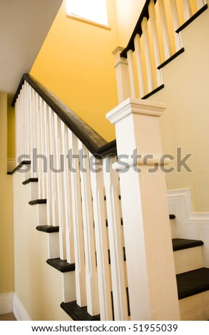 A gently winding staircase inside a large expensive home. - stock photo