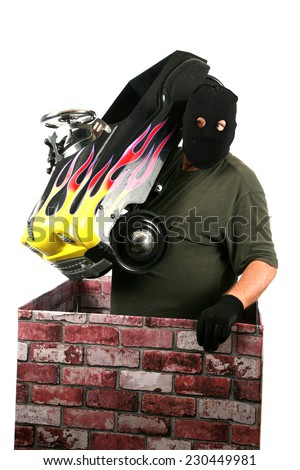 A genuine Bad Guy aka Burglar pops his head out of a chimney looking to see if the coast is clear for his escape after robbing money and valuables from a persons home. Burglars are cowardly thief's  - stock photo