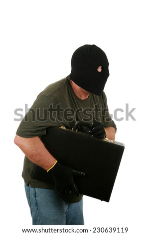 A Genuine Burglar aka Thief or Bad Guy, Robber, Stealer, Masked Man etc. wears a Black Ski Mask to hide his identity as he steals things from unsuspecting people. Isolated on white room for text   - stock photo