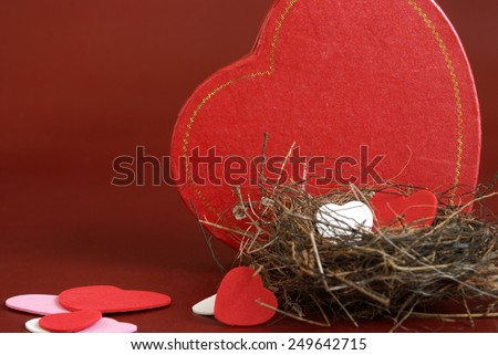 A genuine nest houses some heart shapes in the spirit of love. - stock photo