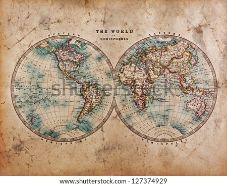 A genuine old stained World map dated from the mid 1800's showing Western and Eastern Hemispheres with hand colouring. - stock photo