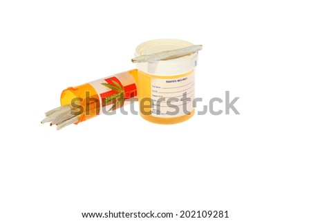 A genuine Urine Test aka Drug Test and Pre Rolled Medical Marijuana Cigarettes.  Isolated on white with room for your text.  - stock photo