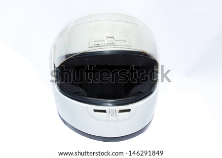 A Genuine White Full Face Motor Cycle Helmet, on a white background. Wearing a motorcycle helmet has saved many peoples lives when in motorcycle accidents. Designed for Safety and Comfort. - stock photo