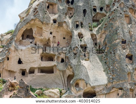 A geological formation consisting of volcanic tuff with cave dwelling. Cappadocia in Central Anatolia is a UNESCO World Heritage Site since 1985, Turkey - stock photo